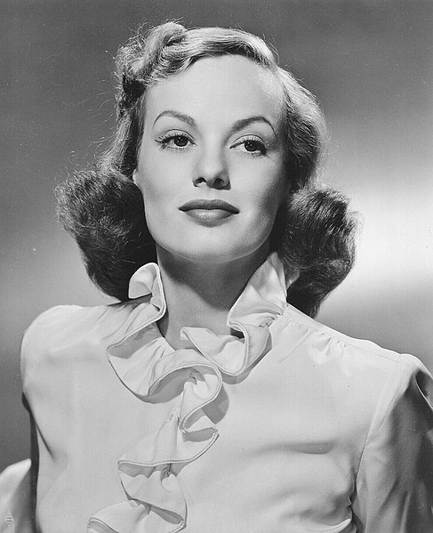 Publicity still of actress Faye Emerson, 1943 (public domain via Warner Bros. Studio)