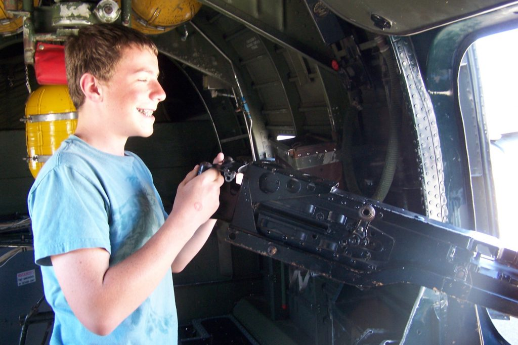 My youngest son manning the waist gun in the Collings Foundation B-17G Nine-O-Nine, Buchanan Field, Concord, CA, June 2013 (Photo: Sarah Sundin)