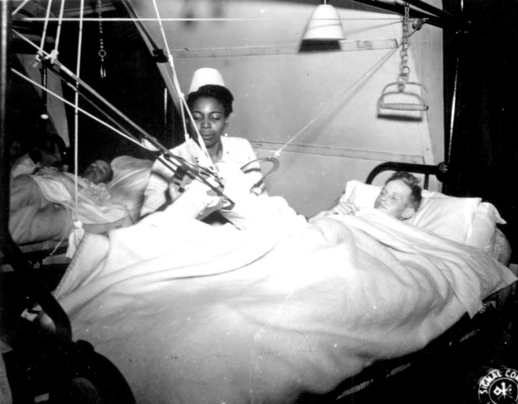 African-American US Army nurse Lt. Florie E. Gant tending a prisoner-of-war patient, England, 7 Oct 1944 (US National Archives)