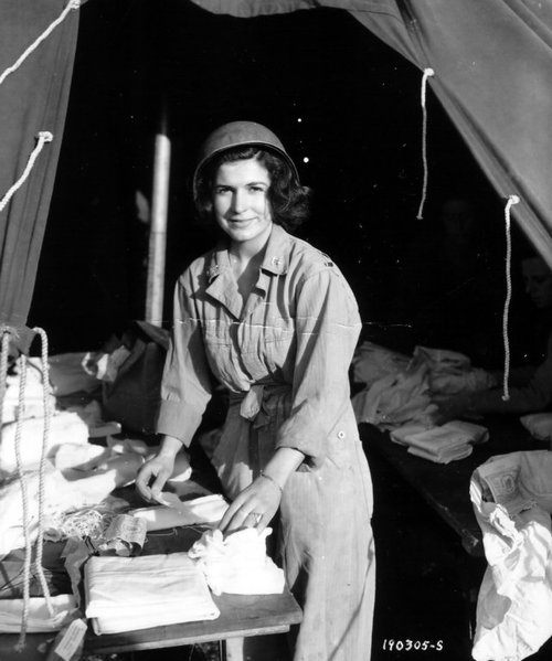 US Army nurse preparing dressings, 15 June 1944, 13th Field Hospital, St.-Laurent-sur-Mer, Normandy (US National Archives)