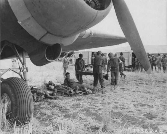 American and Italian wounded at Agrigento, Sicily, await evacuation by plane to Africa for further medical treatment, 25 July 1943 (USAAF photo)