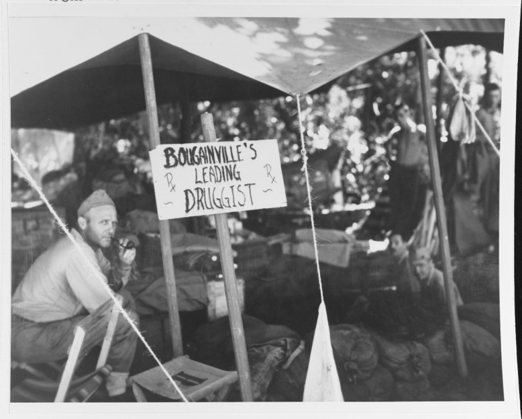 An enterprising Navy Pharmacist's Mate sets up his operation under a tent at Cape Torokina, circa 1-9 November 1943, soon after the initial landings there (US National Archives: 80-G-56402)