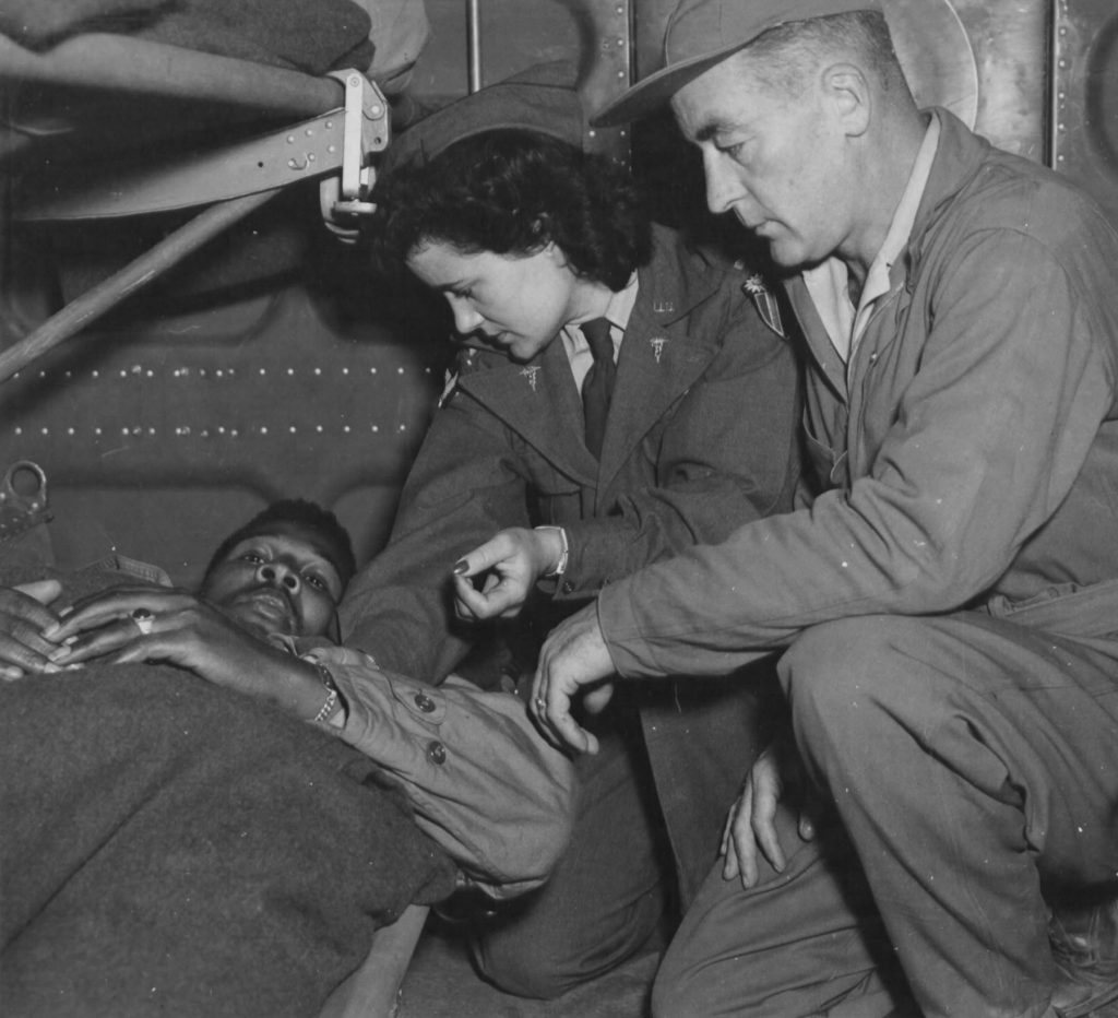 Air evacuation team from 803rd Medical Air Evacuation Transportation Squadron, Lt. Pauline Curry and Tech. Sgt. Lewis Marker, check a patient on a flight over India. (US Air Force photo)
