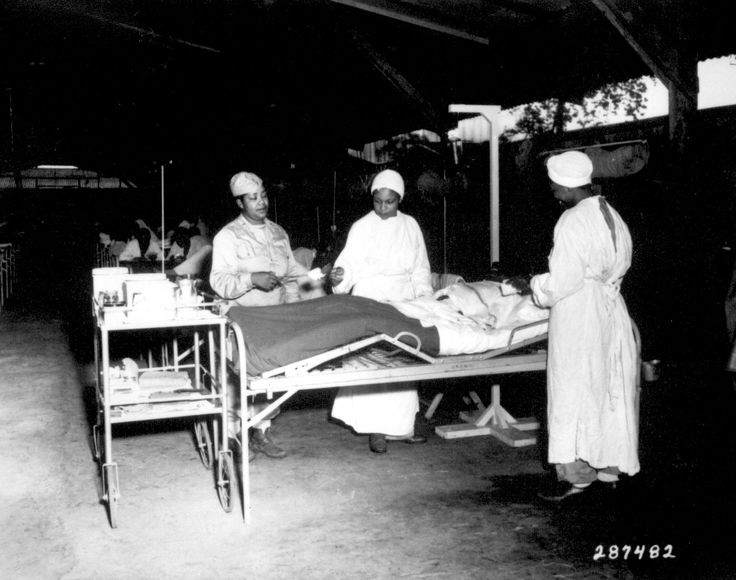 African-American US Army nurses Lt Prudence Burns, Lt Elcena Townscent, and a 3rd nurse treating Sgt Lawrence McKreever 268th Station Hospital, Milne Bay, New Guinea, 22 Jun 1944 (US National Archives)