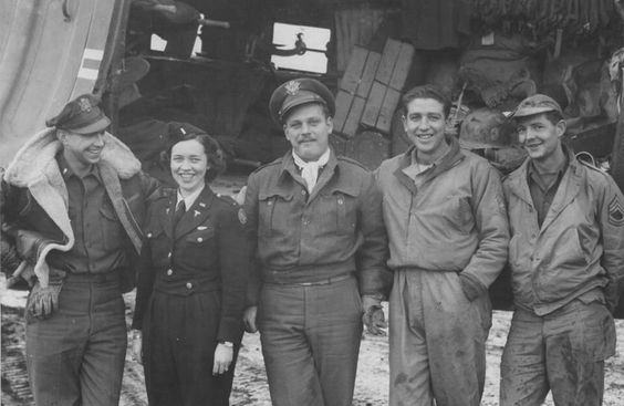 Crew of a medical air evacuation flight: pilot Lt. James M. Hayes Jr.; flight nurse Lt. Katye Swope (802nd Medical Air Evacuation Transport Squadron); co-pilot Lt. C.M. Worley; crew chief T/Sgt. M.C. Jacobsen; radio operator T/Sgt. Leo Mortell (US Army Air Force photo)