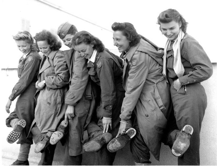 Flight nurses of the 807th MAETS show their worn-out shoes after their two-month trek through Albania, 9 January 1944 (US Air Force photo)