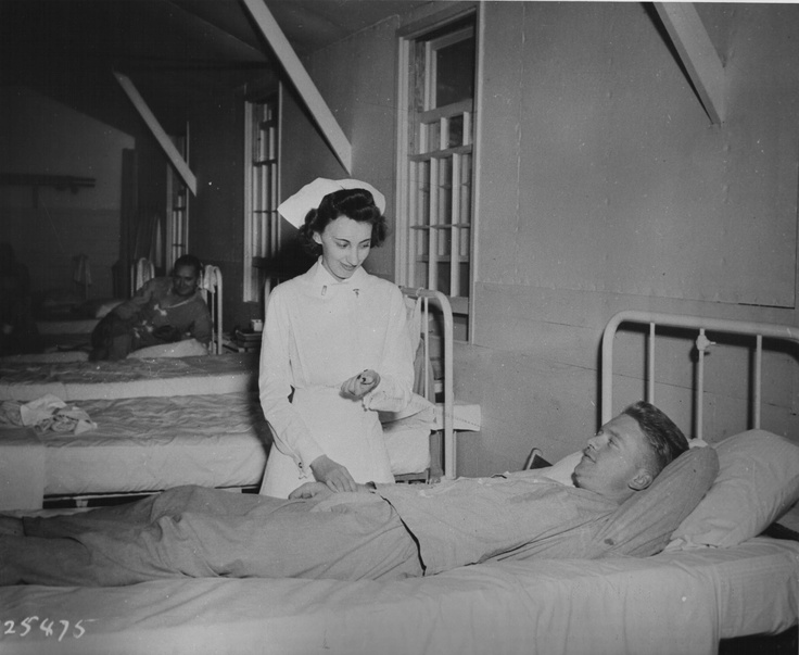 Army nurse attending patient, Camp Forrest, Tullahoma, TN, 22 Sept. 1941 (US Army Medical Dept.)