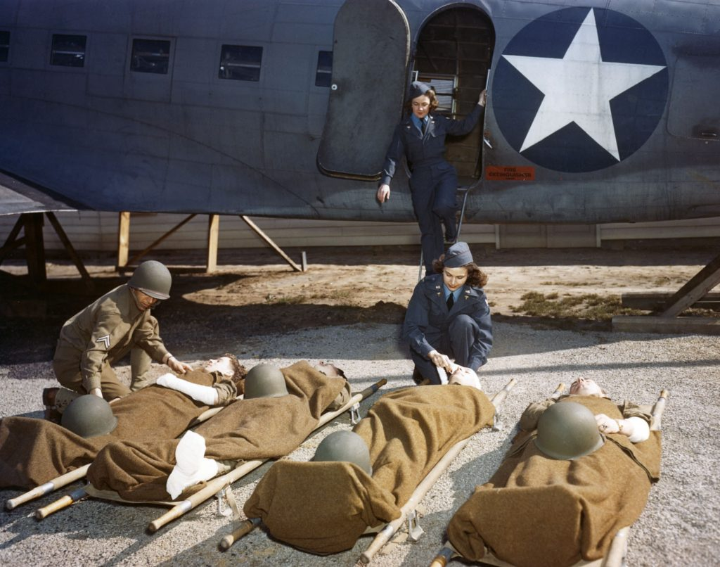 At the Army Air Force School of Air Evacuation at Bowman Field, KY, student flight nurses learn how to handle patients with the aid of a mock-up fuselage of a Douglas C-47 transport. (US Air Force photo)