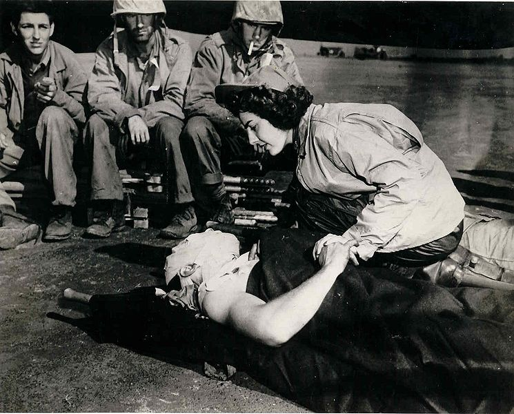 Flight nurse Ens. Jane Kendeigh, US Navy, caring for wounded Marine William J Wycoff on Iwo Jima, March 3, 1945 (US Navy photo)