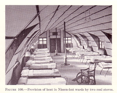 Nissen-hut hospital in England. Note coal stoves in center (US Army Medical Dept.)