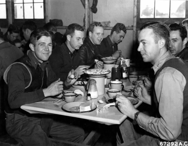 At Alexai Point, Attu, Aleutian Islands, officers of the US 77th Bomb Group and the 54th Fighter Group do justice to the traditional Thanksgiving dinner –the first one celebrated by military personnel on former American territory recaptured from the Japanese, 25 November 1943 (US Army Air Force photo)