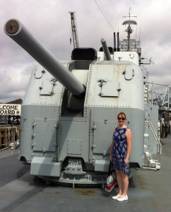 Sarah Sundin at a 5-inch gun mount on the destroyer USS Cassin Young, Charlestown Navy Yard, Boston, July 2014 (Photo: Sarah Sundin)