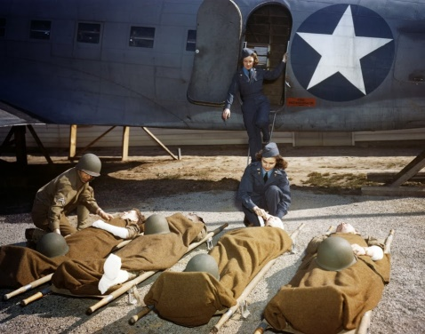 At the Army Air Force School of Air Evacuation at Bowman Field, Ky., student flight nurses learn how to handle patients with the aid of a mock-up fuselage of a Douglas C-47 transport. (U.S. Air Force photo)