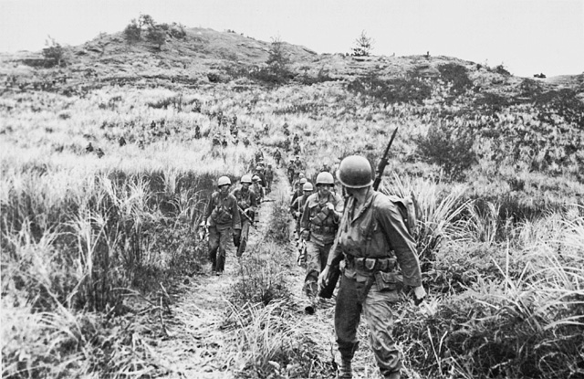 Men of Company B, 305th RCT, moving out from high ground on Guam (US Army Center of Military History)