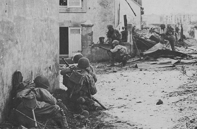Men of US 2nd Infantry Division in Brest, France under fire, 9 September 1944 (US Army Center of Military History)