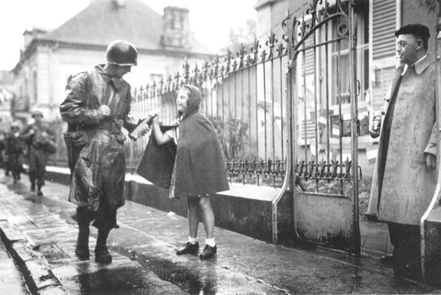 American soldier receives gift from girl in southern France, 1944 (US Army Center of Military History)