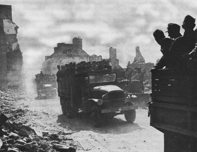 Trucks carry German POWs from the Falaise Pocket, August 1944 (US Army Center of Military History)