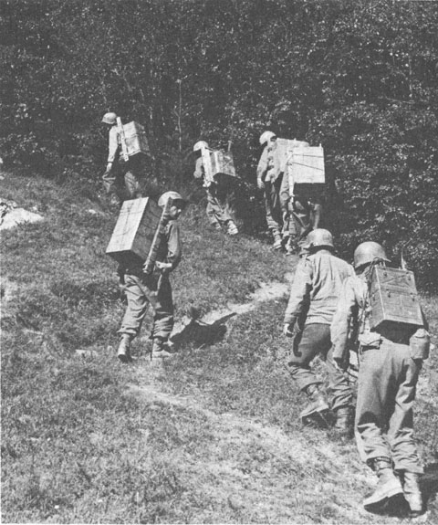 US troops carrying supplies on the Gothic Line (US Army Center of Military History)