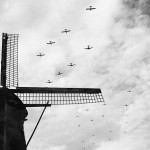 US C-47 Skytrains towing Waco CG-4 gliders over Bergeijk, Holland for the Operation Market Garden landings near Eindhoven, 17 September 1944 (US National Archives)