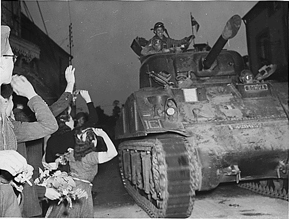 French civilians welcome US troops in Normandy, 14 August 1944. (US National Archives)