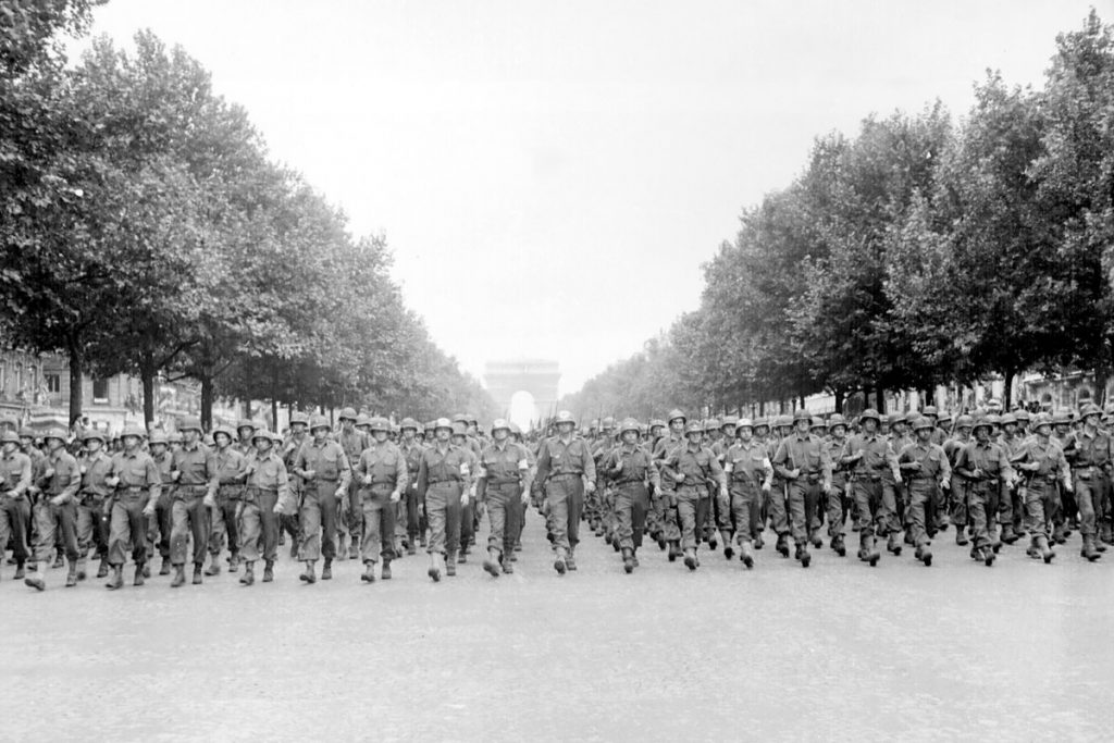 Troops of the US 28th Infantry Division march down the Avenue des Champs-Élysées, Paris, 29 Aug 1944 (US National Archives)
