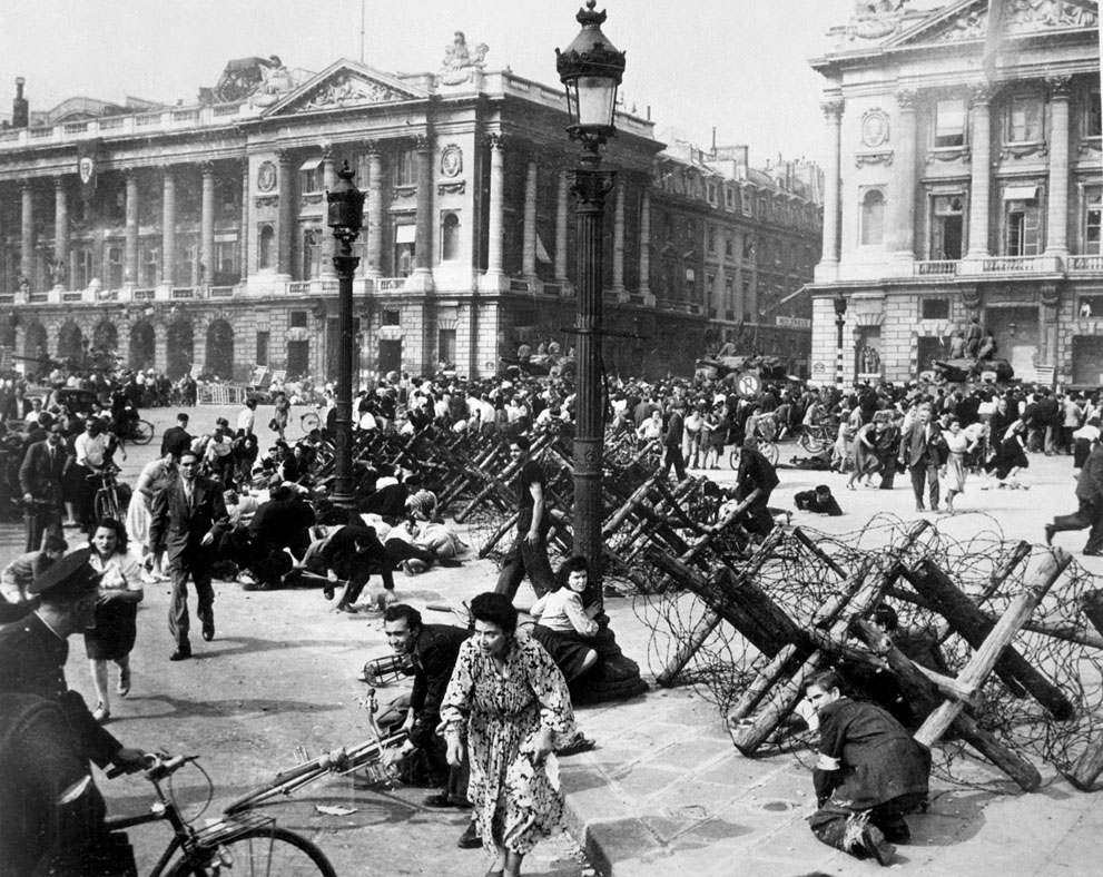 French civilians seeking cover as a German sniper opens fire, Paris, France, 26 Aug 1944 (US Army photo)