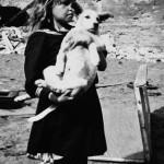 Girl holding her dog in devastated Warsaw, Poland, 5 September 1939 (US Holocaust Museum)