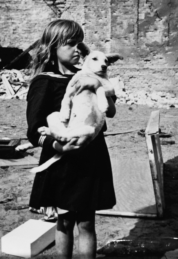 Girl holding her dog in devastated Warsaw, Poland, 5 September 1939 (US Holocaust Museum)