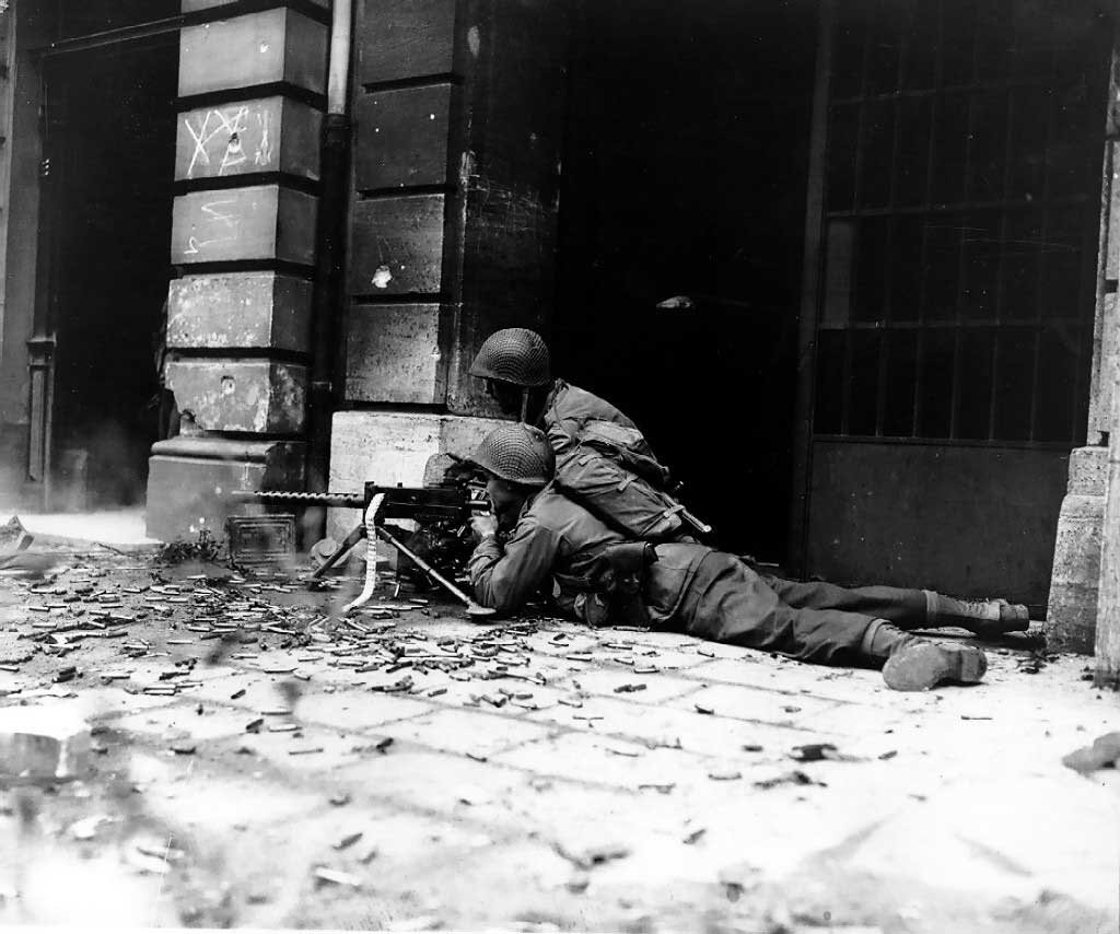 Troops of US 26th Infantry Division in the streets of Aachen, Germany, 15 October 1944 (US Army photo)