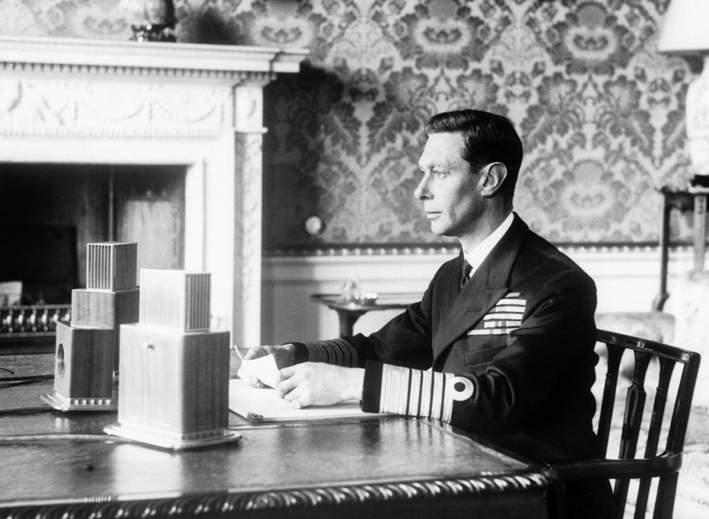 King George VI of the United Kingdom delivering his radio address announcing Britain's entry into the war with Germany, Buckingham Palace, London, Sept 3, 1939 (United Kingdom National Archives)