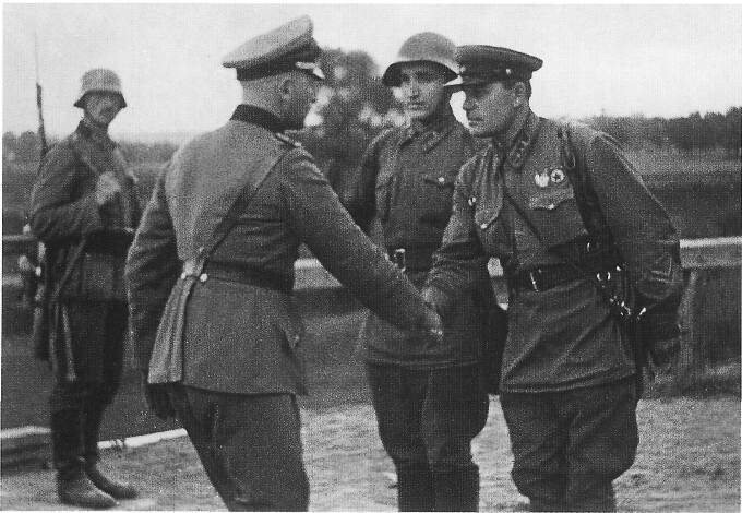 German and Soviet officers shaking hands, Poland, late September 1939 (public domain via WW2 Database)