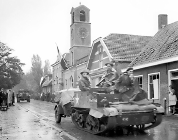 Canadian Royal Hamilton light infantry carriers in Dutch village of Krabbendijke on the Beveland Causeway, 27 Oct 1944 (Library and Archives Canada: PA-205125)