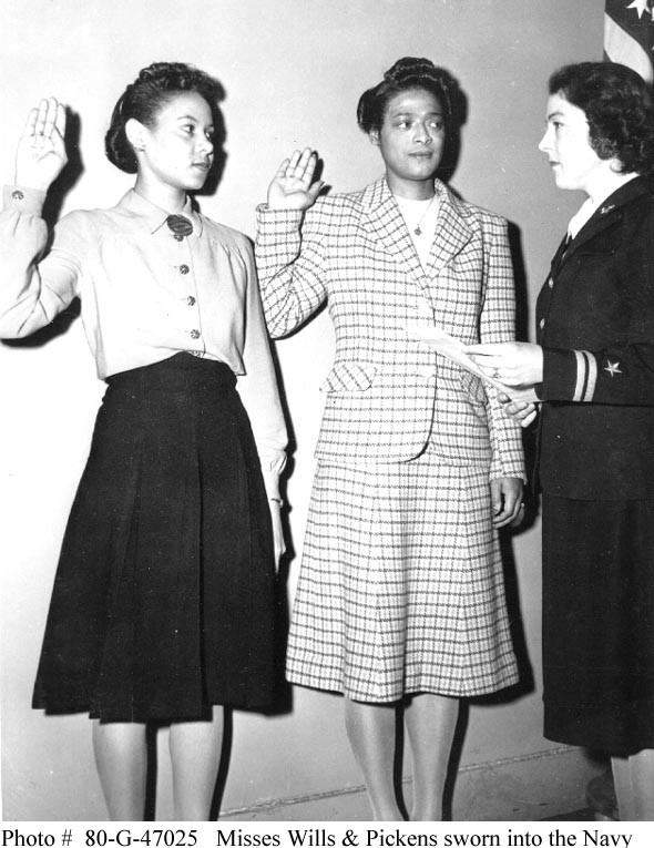 Frances Wills (left) and Harriet Ida Pickens are sworn in by Lt. Rosamond D. Selle, New York City, Nov 1944. In December 1944, they became the Navy's first African-American WAVES officers. (US National Archives: 80-G-47025)