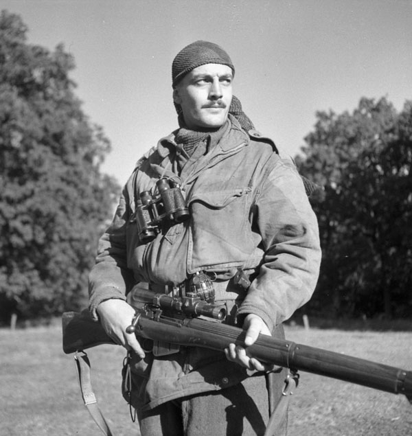 Canadian Calgary Highlanders Sniping Platoon Sergeant Harold A. Marshall posing with his Lee-Enfield No. 4 Mk. I rifle, Kapellen, Belgium, 6 Oct 1944 (Library and Archives Canada: 3206370)