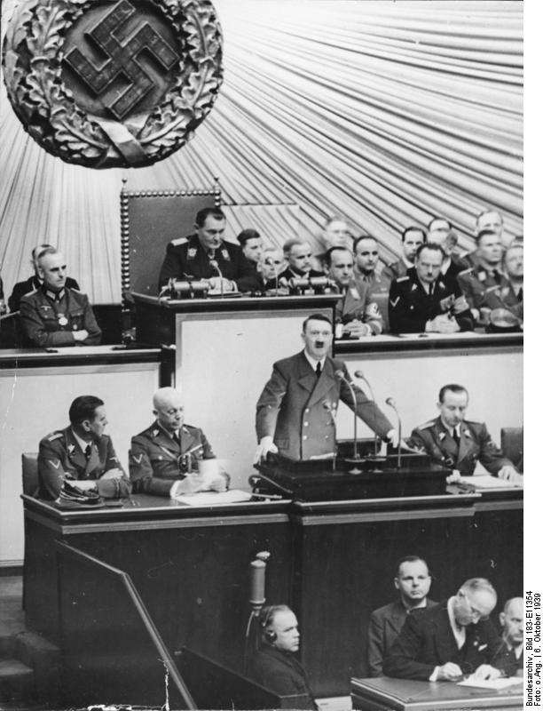 Adolf Hitler giving a speech to the Reichstag, Kroll Opera House, Berlin, Germany, in which he calls for peace talks, 6 Oct 1939 (German Federal Archive: Bild 183-E11354)