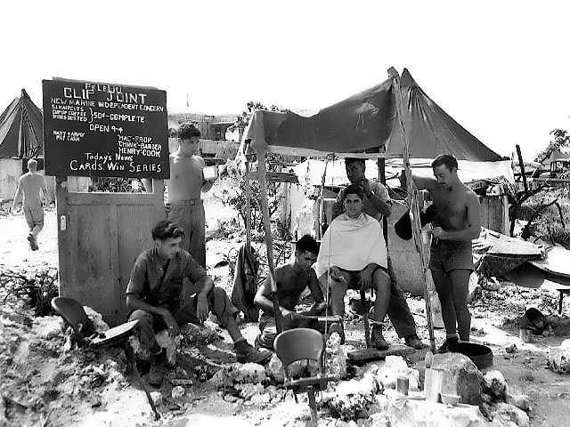 Barber shop set up by a Marine on Peleliu, Palau Islands, 11 October 1944 (US Marine Corps photo 98027)
