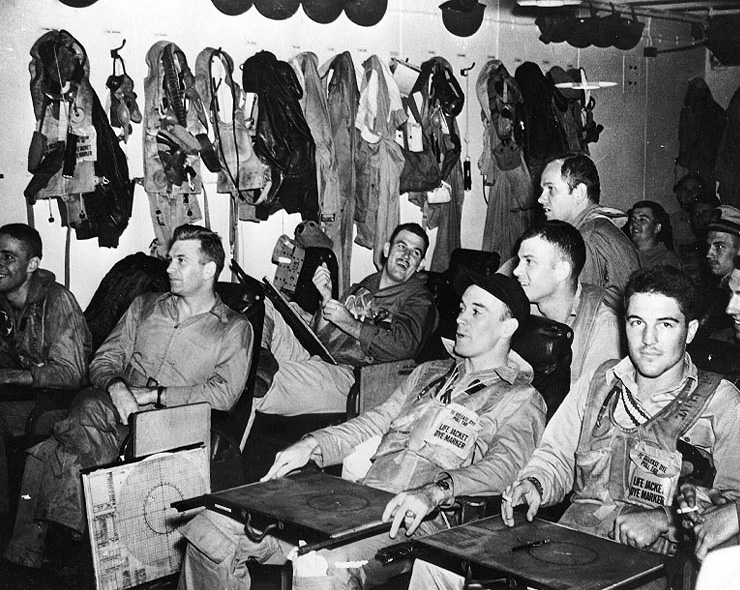 Pilots of US Navy Torpedo Squadron 13 in their ready room aboard carrier Franklin just before the Battle of the Sibuyan Sea during the Battle of Leyte Gulf, 24 Oct 1944 (US National Archives: 80-G-290733)