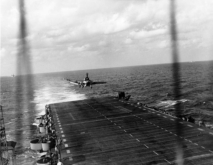 F6F Hellcat fighter landing on light carrier USS Langley after raid on Okinawa, 10 Oct 1944 (US National Archives: 80-G-284074)