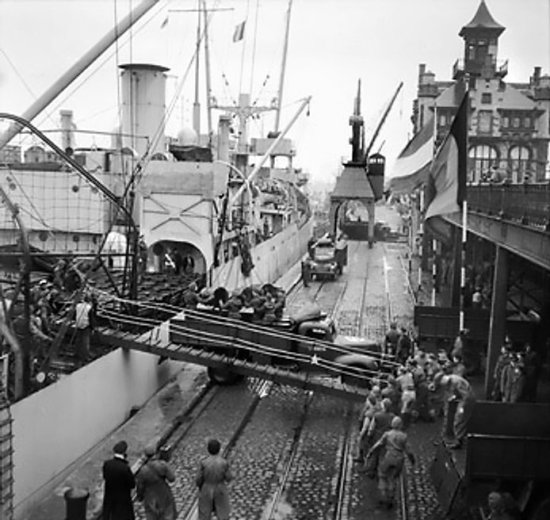 Oil being unloaded from SS Fort Cataraqui at Antwerp, 30 Nov 1944, the first ship to berth at the port after Allied takeover (Imperial War Museum)