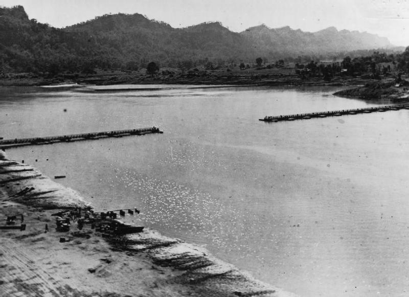 The 1,154-ft ft bridge across the Chindwin River in Burma as it neared completion; this would be the longest Bailey Bridge ever, 2 Dec 1944. (Imperial War Museum)