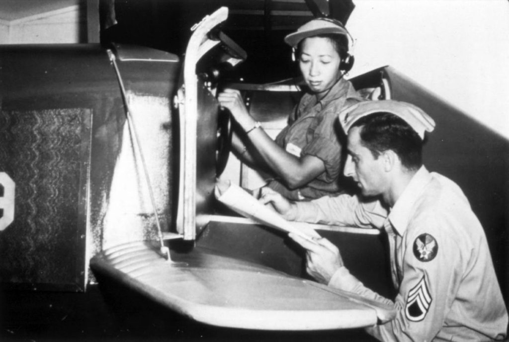 WASP Hazel Ying Lee reviews her performance after a session in a Link trainer, 1944 (US Air Force photo)