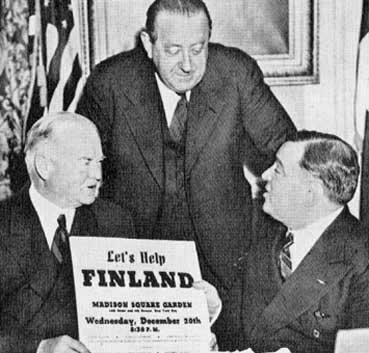 Former US President Herbert Hoover, Dr. van Loon, and Mayor Fiorello LaGuardia raising funds for Finland for the Winter War, New York, New York, 20 Dec 1939 (public domain via WW2 Database)