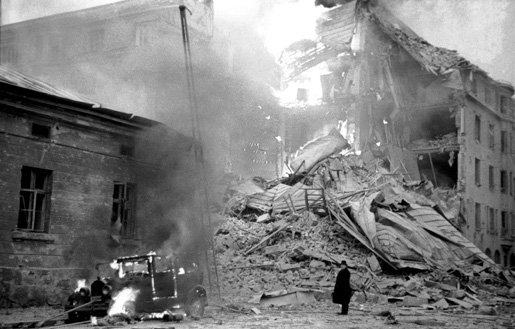 Burning building in Helsinki, Finland after Soviet bombing, 30 November 1939 (public domain via WW2 Database)