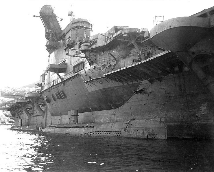 Japanese carrier Junyo at Sasebo, Japan, with 2 midget submarines at her side, 26 Sep 1945 (US Marine Corps photo)