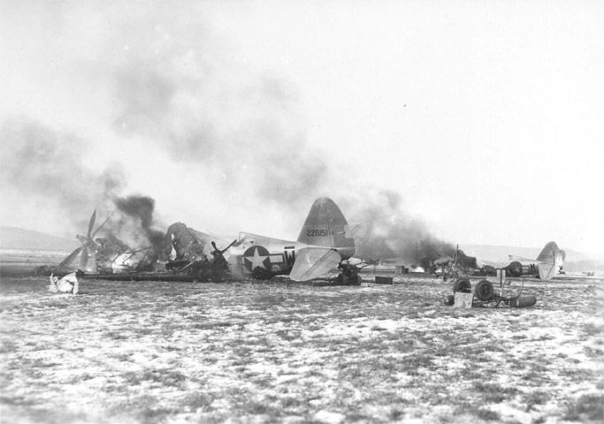 Destroyed US P-47 fighter planes at Metz-Frescaty Airfield, France, 1 Jan 1945 (US Army Air Force photo)