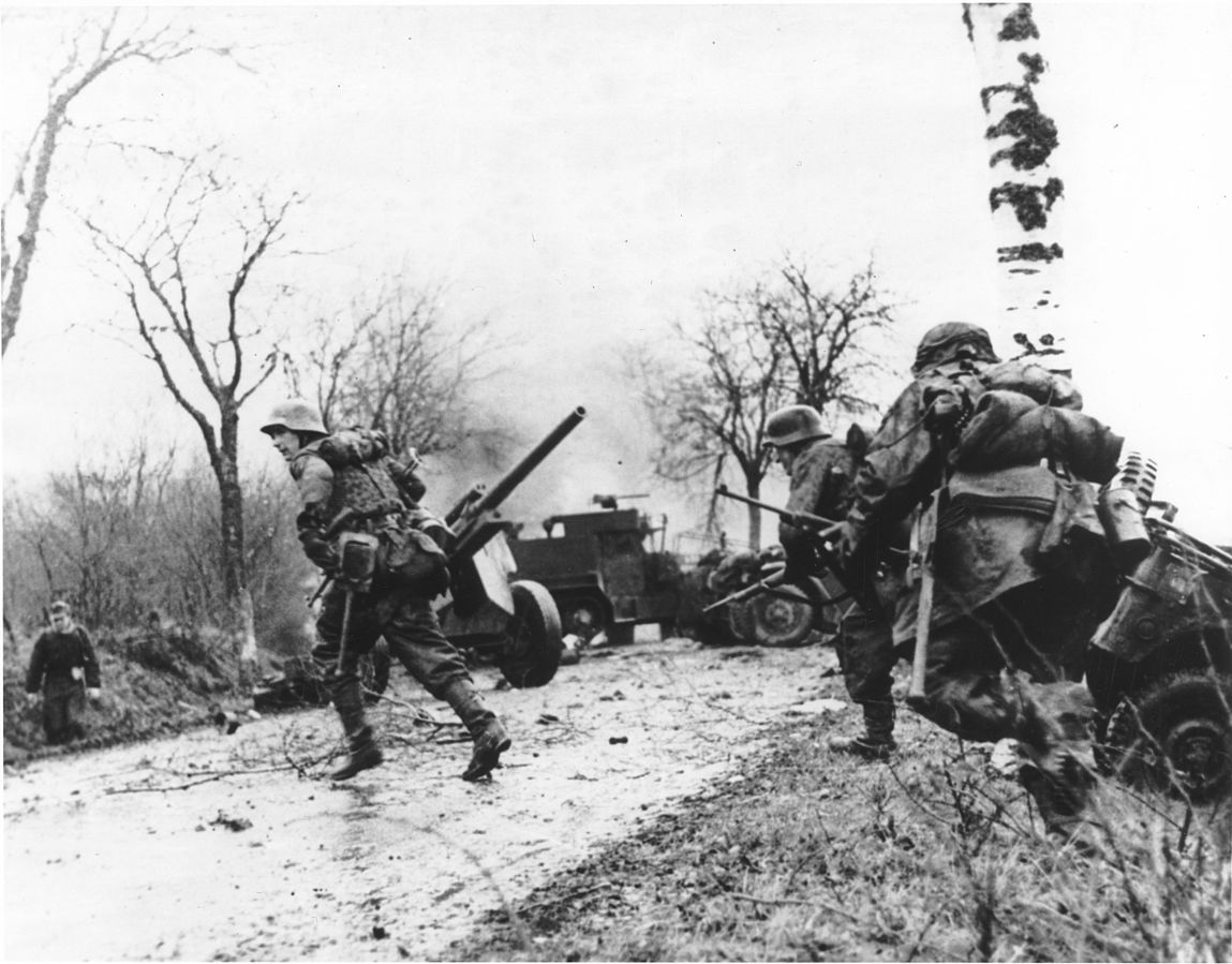 German troops passing abandoned American equipment during the Battle of the Bulge (US Army Center of Military History)