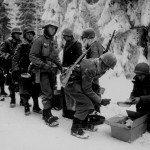 Men of the US 347th Infantry Regiment taking a meal break while en route to La Roche, Belgium, 13 Jan 1945 (US National Archives: 111-SC-198849)