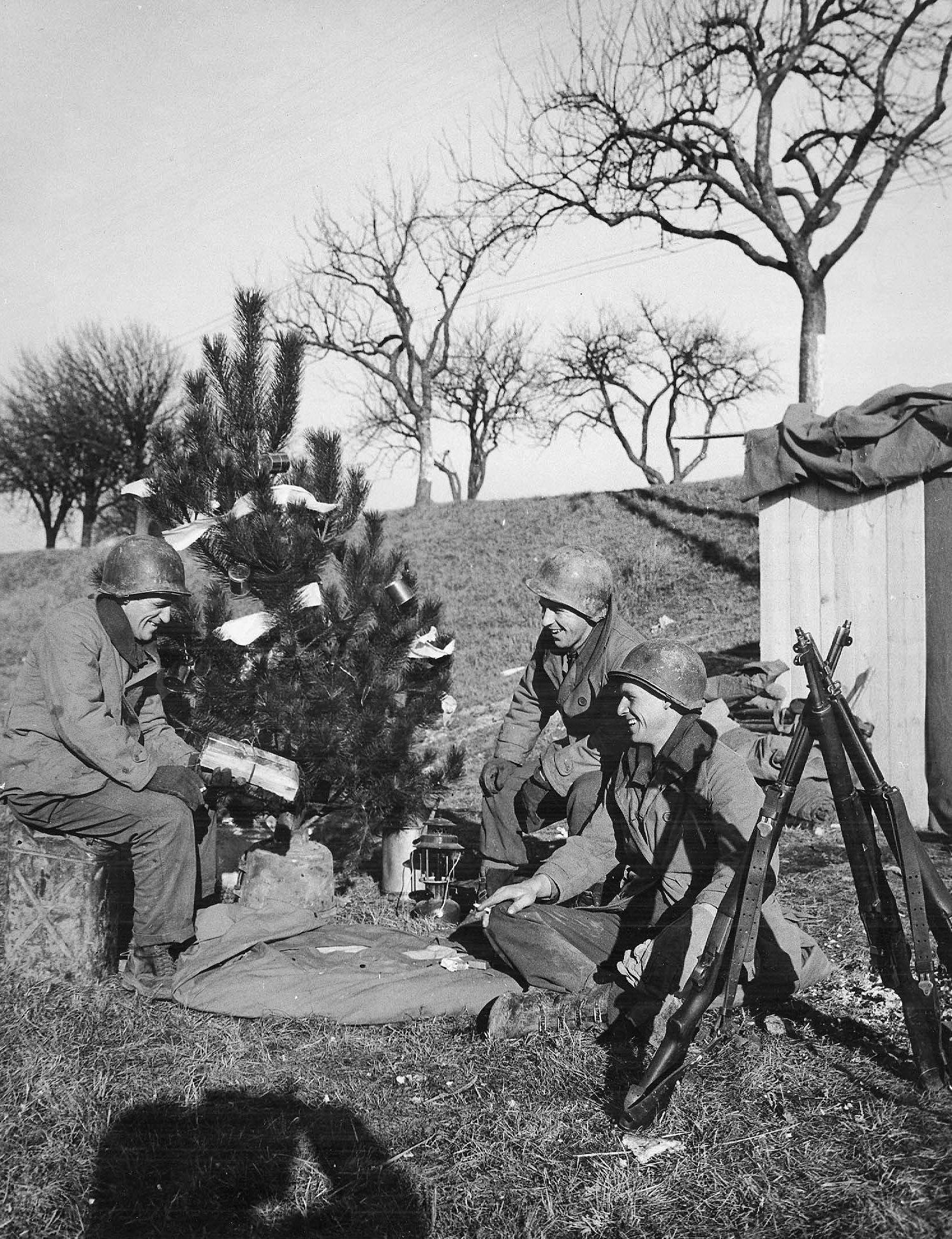 Soldiers of the 463rd Combat Engineers in France near the German border observe Christmas, 25 Dec 1944; note K-ration cans as ornaments (US Army Signal Corps photo)