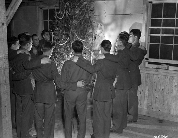 Pennsylvania soldiers in 10th Regiment in Camp Lee's Quartermaster Replacement Center sing carols around the tree, Camp Lee, VA, December 1941 (US Army Center of Military History)