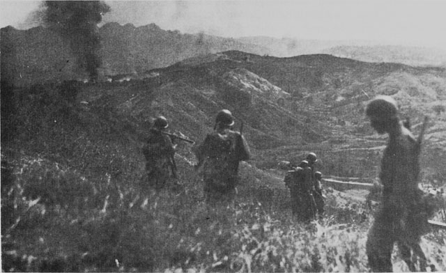 US troops on hill overlooking Damortis-Rosario Road on Luzon (US Army Center of Military History)